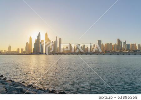 Dubai Downtown skyline with waves on sea beach, 63896568