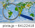 map and a magnifying glass 64122418
