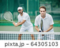 Doubles team of tennis players 64305103