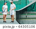 Laughing tennis players 64305106