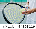 Tenning player getting ready to hit the ball 64305119