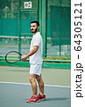 Young Hispanic tennis player 64305121
