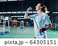 Female badminton player celebrating victory 64305151
