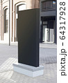 Blank black vertical pylon stand mockup brick building, side view 64317928