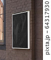 Blank black glass rectangular poster mock up brick wall mounted 64317930