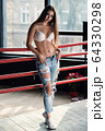 Beautiful blonde woman with fit body in denim jeans 64330298