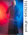 portrait of kendo fighter with bokuto. traditional japanese martial art of sword fighting 64562301