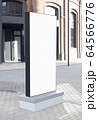Blank white vertical pylon stand mockup brick building, side view 64566776