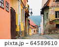Sighisoara old town street colorful houses in Romania 64589610