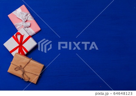lots of gifts for a birthday party on a blue background 64648123