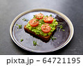 toast bread with mashed avocado and cherry tomato 64721195