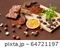 chocolate with hazelnuts, cocoa beans and orange 64721197