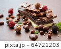 close up of different chocolates, candies and nuts 64721203