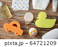 baby accessories for bathing on wooden table 64721209