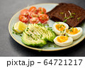 avocado, eggs, toast bread and cherry tomato 64721217