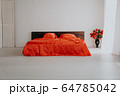 the Interior of the white room with a bed with red 64785042