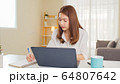 Asian woman work at home or modern office, using notebook laptop computer. Work from home life 64807642