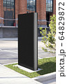 Blank black vertical pylon stand mockup brick building, side view 64829872