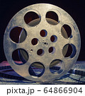 35 mm film reel with dramatic lighting on a dark 64866904