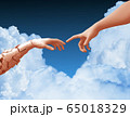 Two Hands And Clouds In The Blue Sky Create A Heart Shape 65018329