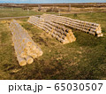 Rolls of haystacks on the field as agriculture harvest concept. 65030507