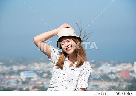 Woman relax at sea viewpoint in concept travel 65093067