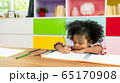 Young African American kid girl drawing, preschool child study at home. Homeschooling concept 65170908
