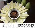 Raw mango fruit and some slice 65223542
