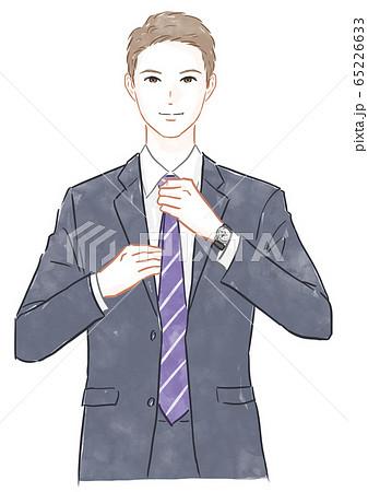 ネクタイを締める男性 65226633