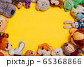 Children's soft toys for developing baby games on a yellow background 65368866