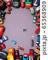 Children's cars toys for developing baby games on a gray background 65368909