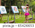 Archery for child. Kids shoot a bow. Arrow, target 65426653