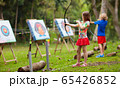 Archery for child. Kids shoot a bow. Arrow, target 65426852