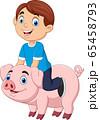 Cartoon happy little boy riding pig 65458793