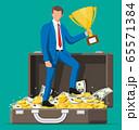 Businessman holding trophy 65571384