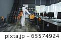 Men in hazmat suits disinfecting office 65574924