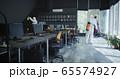 Men in hazmat suits disinfecting office 65574927