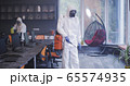 Men in hazmat suits disinfecting office 65574935