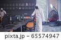 Men in hazmat suits disinfecting office 65574947