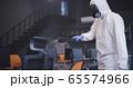 Men in hazmat suits disinfecting office 65574966