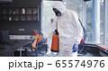 Men in hazmat suits disinfecting office 65574976