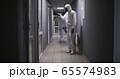 Men in hazmat suits disinfecting building 65574983
