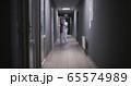 Men in hazmat suits disinfecting building 65574989