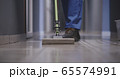 Janitor cleaning a corridor 65574991