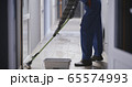 Janitor cleaning a corridor 65574993