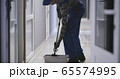 Janitor cleaning a corridor 65574995