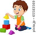 Cartoon boy playing with building blocks 65583569