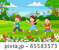 Children catching a butterfly in the park 65583573