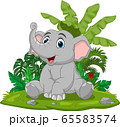 Cartoon baby elephant sitting in the grass 65583574