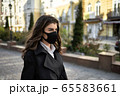Girl posing outdoors during pandemic of COVID-19 65583661